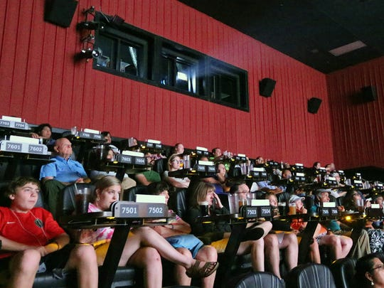 Movie goers watch the USA Today Network documentary 'The Wall' Monday night at Alamo Drafthouse Cinema in West El Paso.