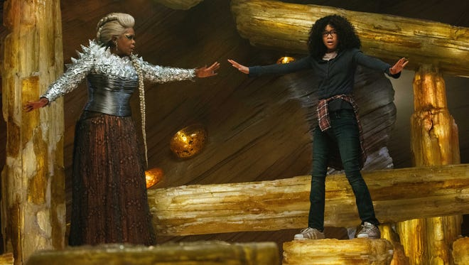 "Mrs. Which (Oprah Winfrey) guides Meg (Storm Reid) on her journey to rescue her father in ""A Wrinkle in Time."""