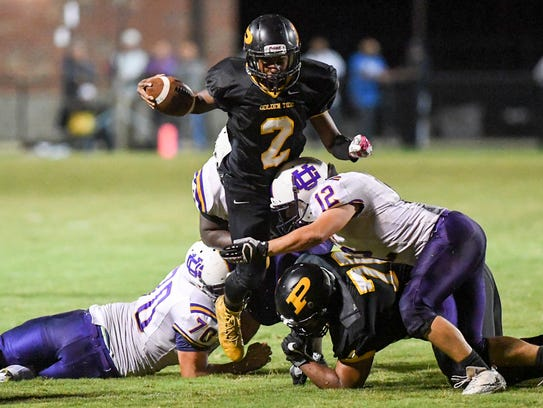 Peabody's Courtlen Wade attempts to jump over Union