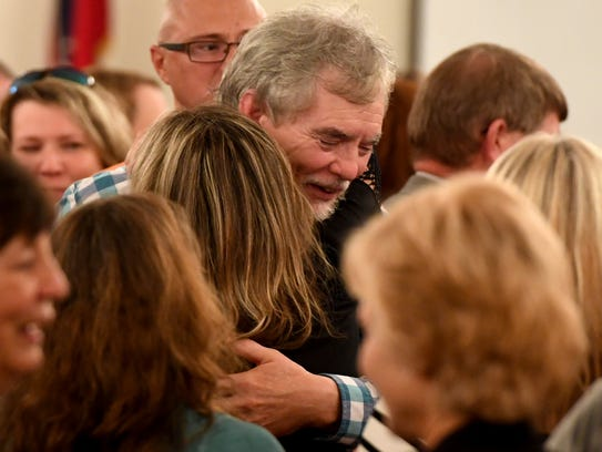Dana and Karen Bobo hug each other after a Hardin County