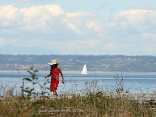 A Bainbridge Island resident walks along the shore of Fay Bainbridge Park. Claims that Kitsap County has the longest shoreline has surfaced as part of tourism and visitor campaigns.  (MEEGAN M. REID / KITSAP SUN)