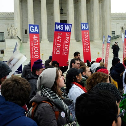 Supporters of the Affordable Care Act rally outside