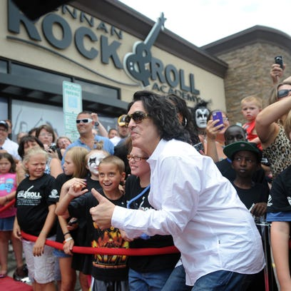 KISS member Paul Stanley gives a thumbs up while he