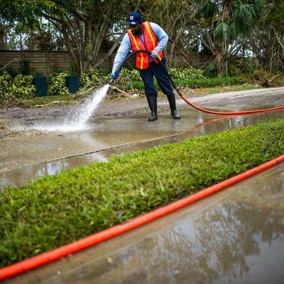 Darryl Jones, of St. Petersburg, sprays sewage on Mahogany