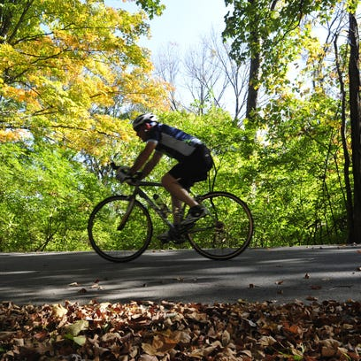 A bicyclist rides through Percy Warner Park. Brentwood's