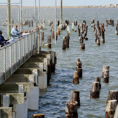 A couple of fishermen trying their luck from the end of the fishing pier at Cape Henlopen State Park. The legislature is working on funding for improvements the Delaware's state parks.