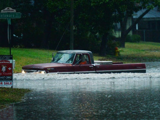 A truck drives on a flooded Gilbert Drive in Shreveport