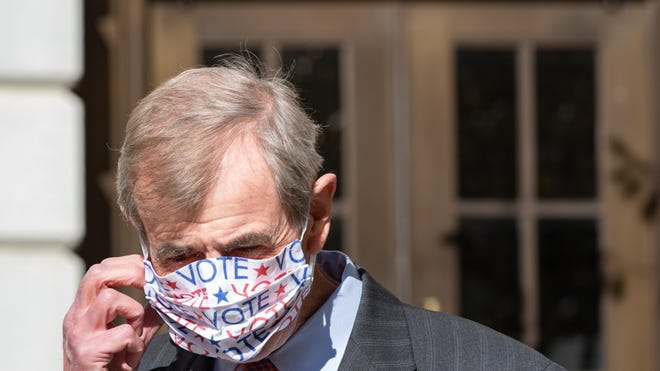 """Secretary William Galvin sported a festive facemask as he prepared for a post-election press briefing Wednesday, Nov. 4. """"Yesterday was a great day for democracy in Massachusetts,"""" he told reporters."""