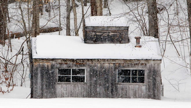 A maple syrup sugar house is surrounded by snow March 5 in Antrim, N.H. More snow is forecast for New England this week.