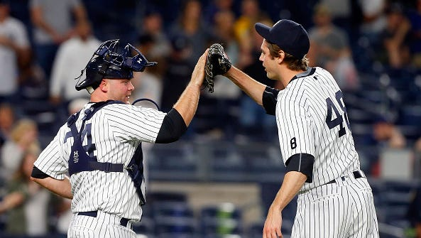 NEW YORK, NY - APRIL 22:  Brian McCann #34 and Andrew Miller #48 of the New York Yankees celebrate after defeating the Tampa Bay Rays at Yankee Stadium on April 22, 2016 in the Bronx borough of New York City.