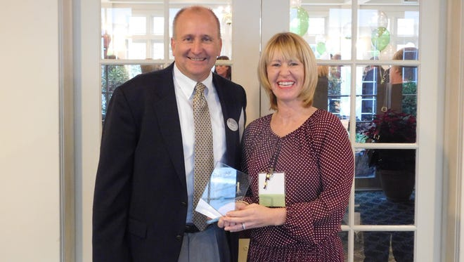 Richard Johnston, executive director, United Methodist Communities at Francis Asbury and Amanda Wolfe, winner of a LeadingAge Excellence in Care Award.