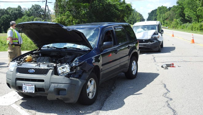 Two of the four vehicles that were involved in a minor injury collision on Ohio 16 near Conesville on Monday.