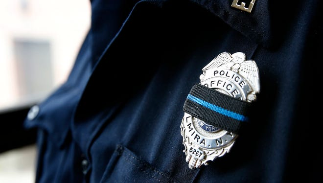 Elmira police will wear mourning bands over their badges for one month in memory of the five Dallas officers killed on July 7. The bands are black with a blue stripe.