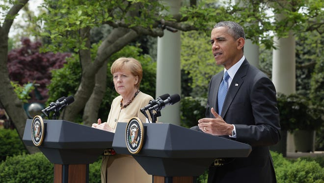 German Chancellor Angela Merkel and President  Obama address the media in the Rose Garden at the White House on May 2, 2014.