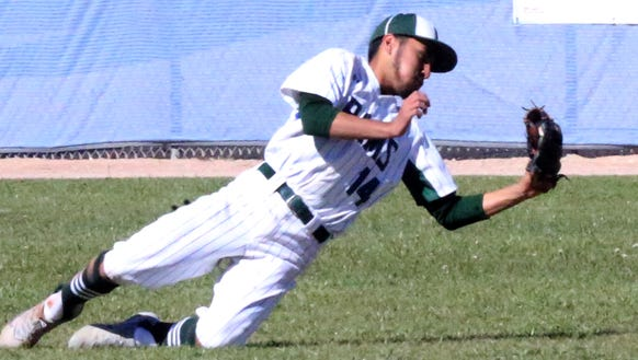 Montwood outfielder Peter Mirano makes a falling catch