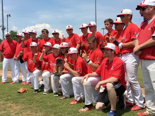 Riverheads coaches and players pose with the championship trophy after defeating Honaker 13-1 to win the VHSL Class 1 baseball championship on Saturday, June 9, 2018, at Radford University in Radford, Va.