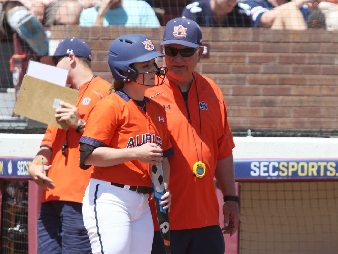 Auburn junior Haley Fagan talking to Auburn coach Clint Myers before an at-bat in SEC Tournament quarterfinal 6-4 win over Alabama on May 13, 2016.