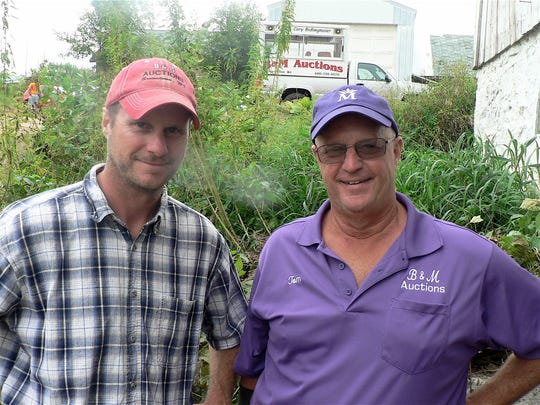 Cory (left) and Tom Bidlingmaier of B&M  Auctions, Browntown, have sold five dairy herds in the past month or so. All cited the low milk price as a factor.