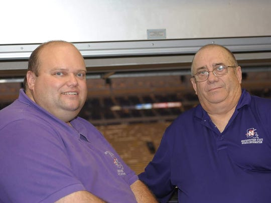 Davey Antilley and his father David Antilley stand in LSU's press box during a 2011 game. Antilley and his son Davey have served in various roles at NSU athletics for nearly 30 years.