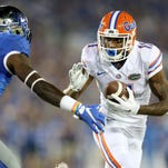 Demarcus Robinson of the Florida Gators runs with the ball while defended by J.D. Harmon of the Kentucky Wildcats at Commonwealth Stadium on September 19, 2015.