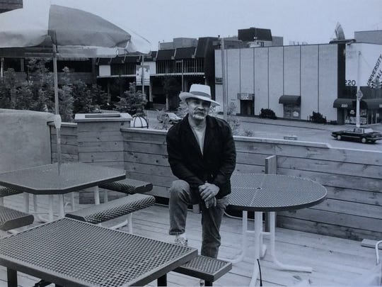 Arturo Santa Cruz, owner of the El Azteco restaurants, relaxes on the rooftop dining area of the East Lansing branch. He also owns an El Azteco in Lansing.