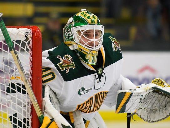 Vermont goalie Stefanos Lekkas (40) keeps an eye on