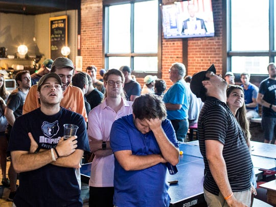 Grizzlies fans, from left, Frederick Scharff, John Brand and Conner Forrester react after seeing the Grizzlies receive the fourth pick in the 2018 NBA Draft on Tuesday.