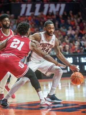 Illinois guard Mark Alstork (24) tries to get around Indiana forward Freddie McSwain Jr. (21) during the first half of an NCAA college basketball game in Champaign, Ill., Wednesday, Jan. 24, 2018. (AP Photo/Rick Danzl)