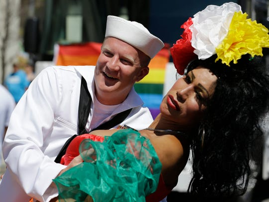 Lee Reinhart, left, dances with Bianca Dorres at the 45th Annual Chicago Pride Parade on Broadway in Chicago, Sunday, June 29, 2014. The event, the first since Illinois' law allowing same-sex marriage went into effect, has 200 registered entrants, with about 1 million expected to participate.
