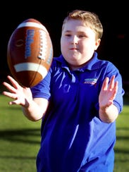 Colton Sheets plays a little catch as he visits the