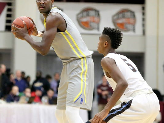 FILE - In this Jan. 14, 2017, file photo, Hillcrest Prep's DeAndre Ayton looks to pass against Westtown School during a high school basketball game at the 2017 Hoophall Classic in Springfield, Mass. Ayton, who is from the Bahamas, has averaged 26 points and 10.5 rebounds in two preseason exhibition games with the third-ranked Arizona Wildcats. (AP Photo/Gregory Payan, File)