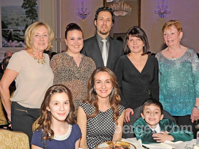 Standing: Peggy Rothfritz, Stephanie Kacperowski, Sam Papasavas, Visha Warchoo and Kathy Briedon.  Seated: Alexa Papasavas, Carla Papasavas and Jayden Papasavas (Photo by Hildi Borkokwski)