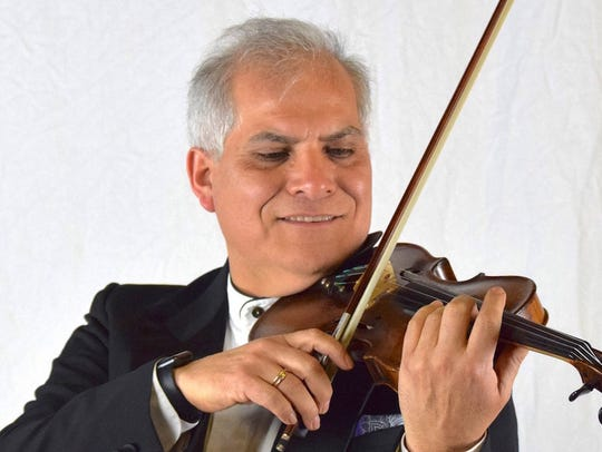 Violinist Augusto Diemecke, concertmaster for the Orchestra