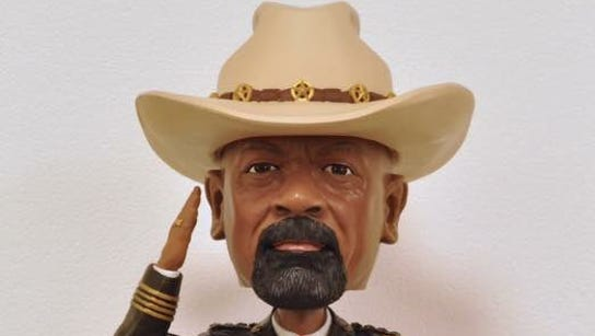 Sheriff David A. Clarke Jr. bobblehead being distributed