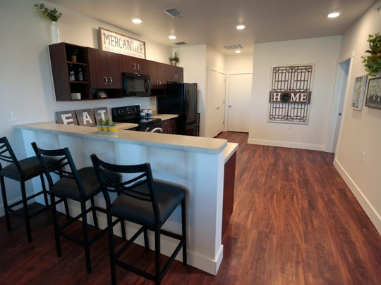 A kitchen in a three bedroom apartment at the Talia