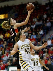 River Falls' Karly Murphy (42) and Sydney Mueller (13) try to defendas  Cedarburg's Kylee Marks shoots during the second half of their Division 2 semifinal.