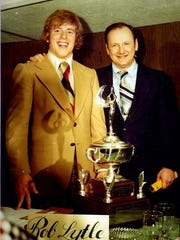 Bo Schembechler and Rob Lytle celebrating at the Michigan Amateur Athlete Banquet, 1976,