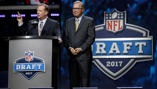 NFL commissioner Roger Goodell, left, speaks with former Philadelphia Eagles' Ron Jaworski before the second round of the 2017 NFL football draft, Friday, April 28, 2017, in Philadelphia.