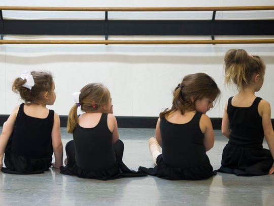 Ballet dancers wait for instruction during their Creative