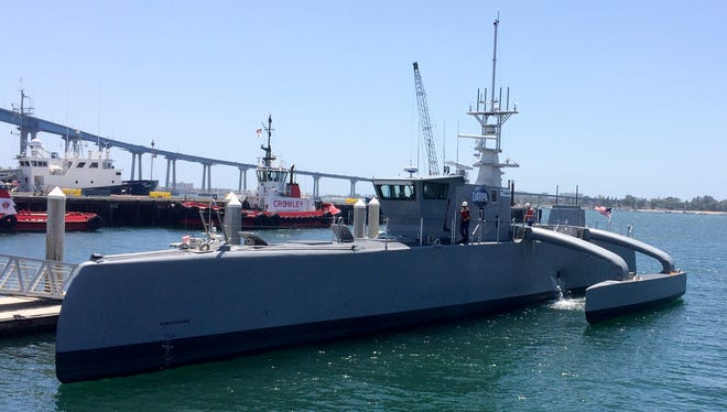 A self-driving, 132-foot military ship sits at a maritime terminal Monday, May 2, 2016, in San Diego. The Pentagon's research arm is launching tests on the world's largest unmanned surface vessel designed to travel thousands of miles out at sea without a single crew member on board. (AP Photo/Julie Watson)