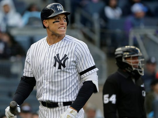 New York Yankees' Aaron Judge reacts after striking out during the third inning of a baseball game against the Baltimore Orioles at Yankee Stadium Sunday, March 31, 2019, in New York. (AP Photo/Seth Wenig)