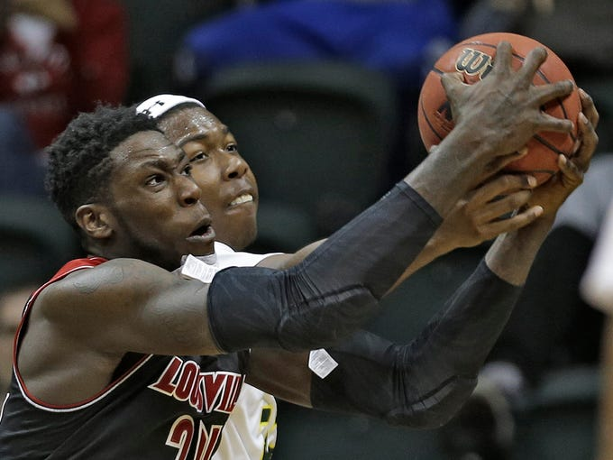 Louisville forward Montrezl Harrell, front, grabs a rebound away from South Florida forward/center Chris Perry during the second half of an NCAA college basketball game Wednesday, Jan. 22, 2014, in Tampa, Fla. Louisville defeated South Florida 86-47. (AP Photo/Chris O'Meara)