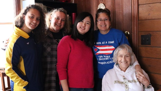 Puerto Rico One Box at a Time volunteers, from left, Amber White of Spencerport, Lisa Beth Nanartowich from Spencerport, Nanako Kakishima, an international rotary exchange student from Japan being hosted by the Spencerport Rotary Club, Maria Delgado Sutton, from Spencerport and the group's founder, and Lois Sutton, from Spokane, Washington.