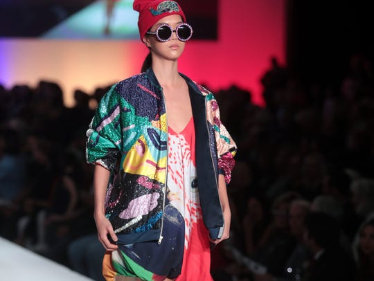 Model wearing Margarita Alvarez's design walks the