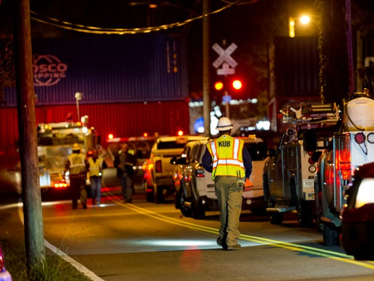 KUB workers arrive at the scene of a 50-car train derailment