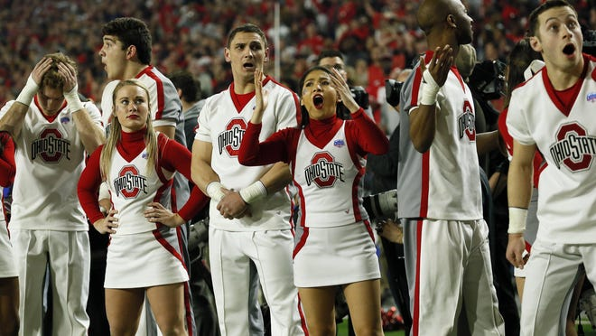 Ohio State Buckeyes cheerleaders react to an overturned replay call on what they thought was a touchdown by running back J.K. Dobbins (2) during the second quarter of the College Football Playoff Semifinal against the Clemson Tigers at the PlayStation Fiesta Bowl at State Farm Stadium in Glendale, Ariz. on Saturday, Dec. 28, 2019.