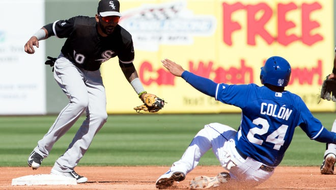 Chicago White Sox infielder Alexei Ramirez, left, prepares to tag out Kansas City Royals infielder Christian Colon at second base on March 10, 2015.