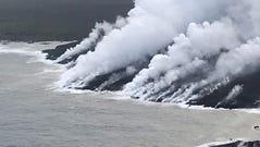 Lava from Mt Kilauea enters the sea near Kapoho, Hawaii,