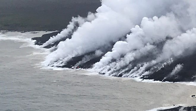 Lava from Mt Kilauea enters the sea near Kapoho, Hawaii, June 12, 2018