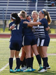 Notre Dame players celebrate their 2-1 win over Trumansburg in the Section 4 Class C final Oct. 28 at Norwich.